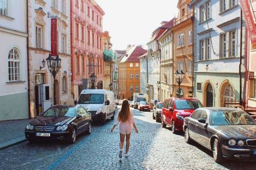 Everything about Eurail | Girl in the colorful streets, Prague, Czech Republic