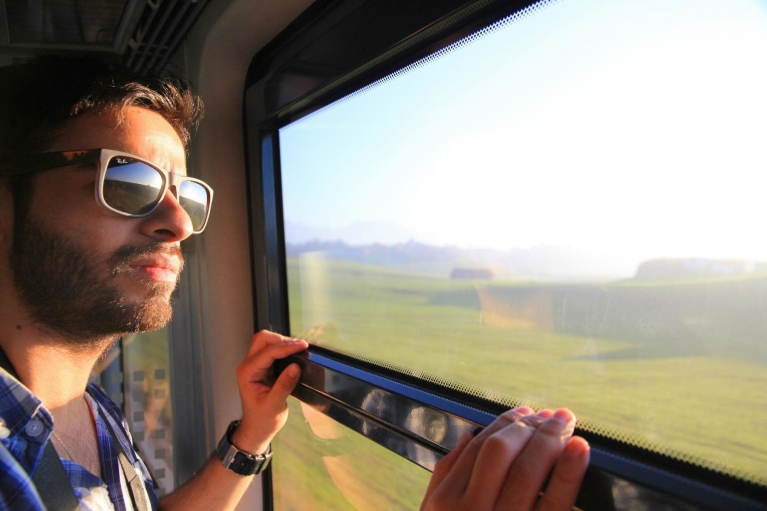 guy_looking_out_of_train_window