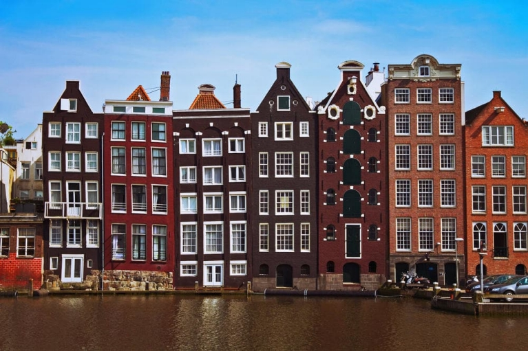Dutch buildings and canal in Amsterdam, the Netherlands