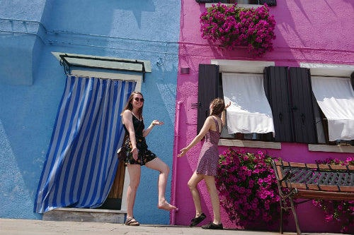 two_girls_being_silly_in_burano_venbice_italy_resized
