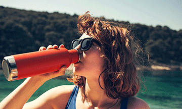 girl-drinking-water-from-reusable-bottle