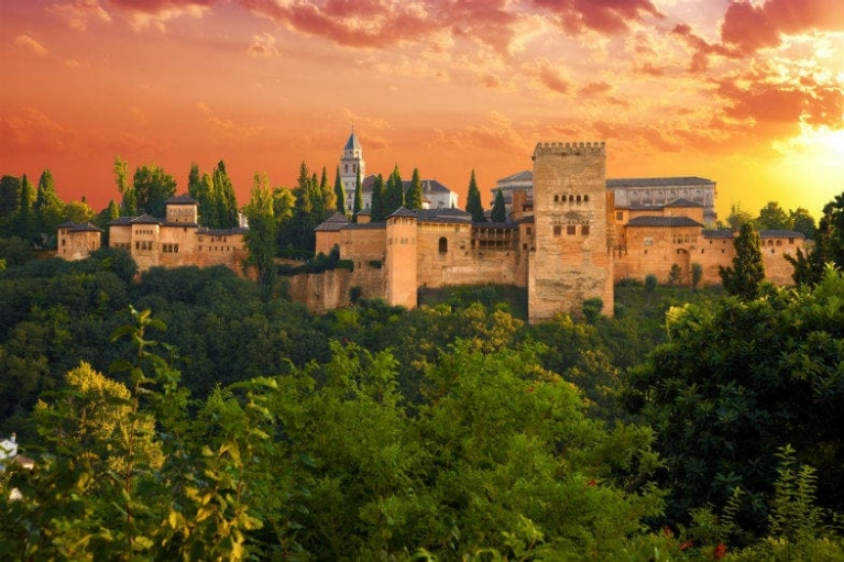 top_10_interrail_destinations_-_exterior_view_of_alhambra_de_granada_in_spain_during_sunset