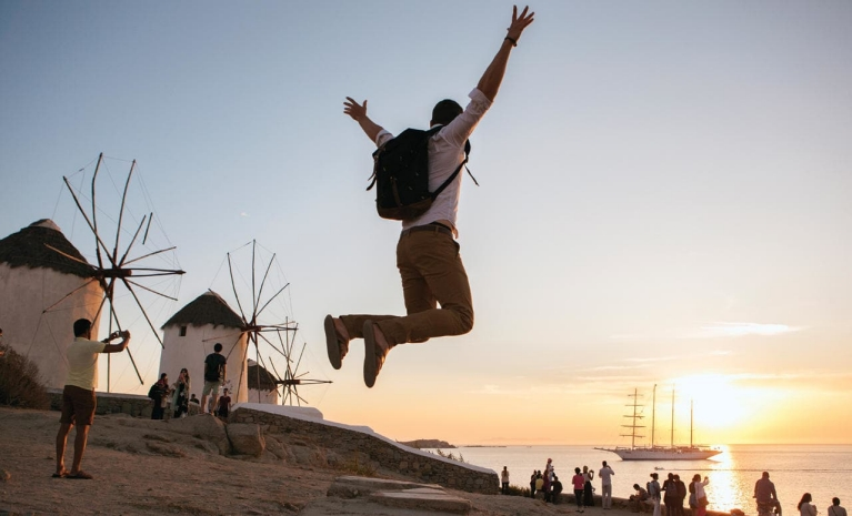 young_man_jumping_on_beach